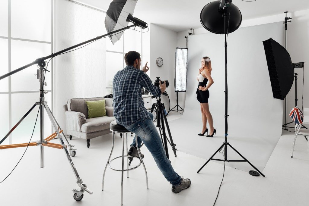 Model having a photoshoot at a studio