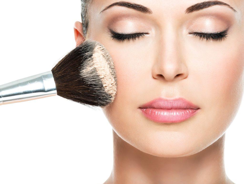 Woman putting makeup