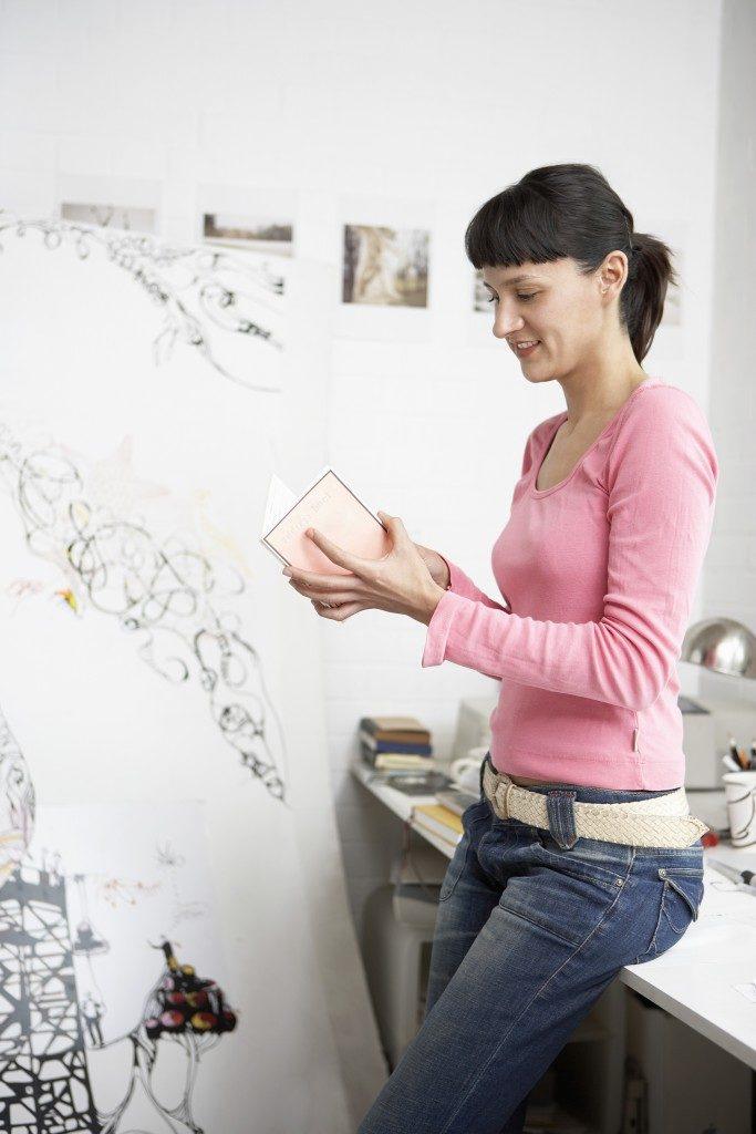 female artist in her flat in london