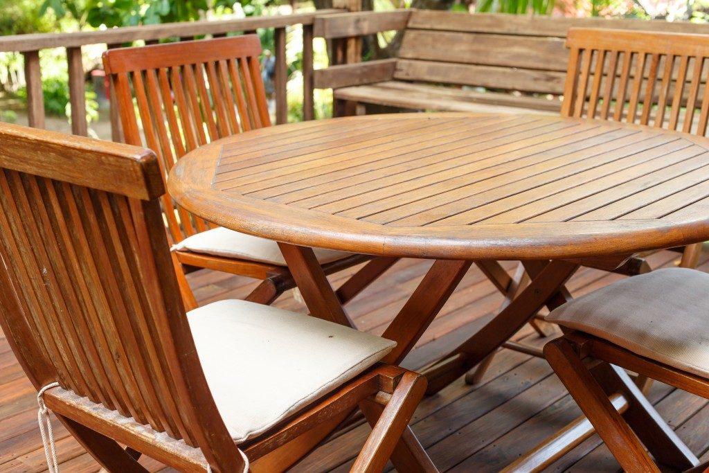 Teak wood furniture on patio