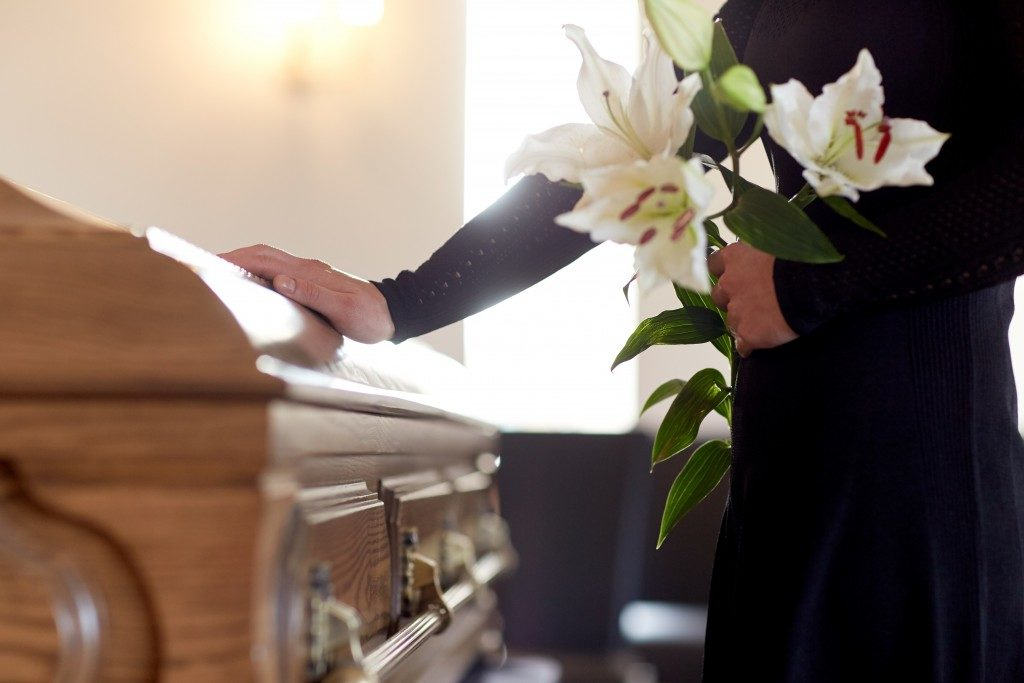 Woman holding flower at a funeral