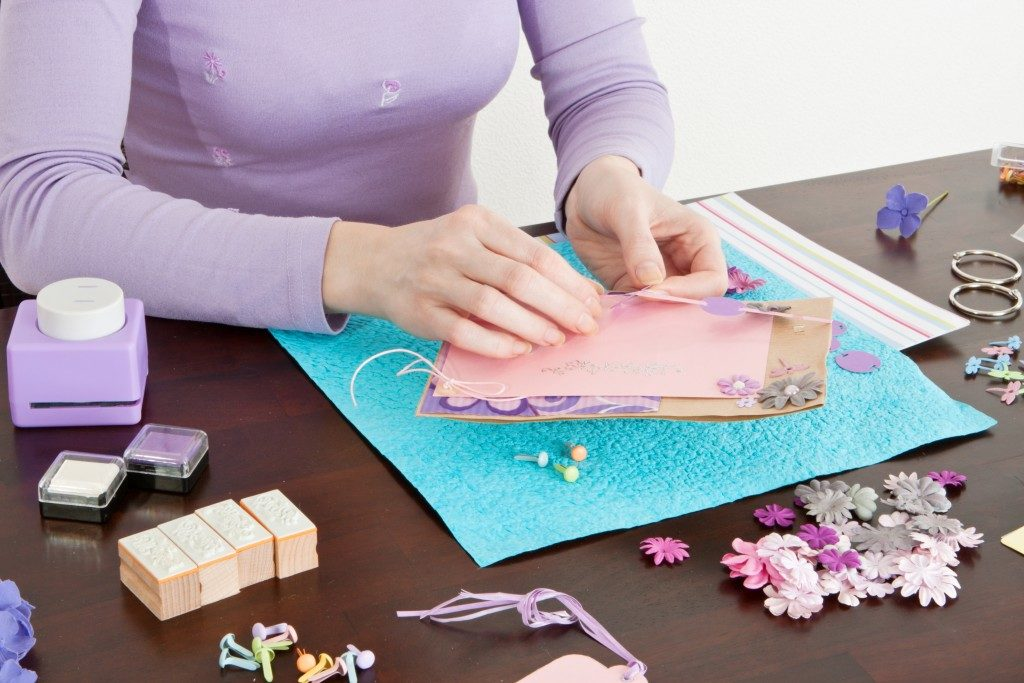 Woman creating a scrapbook