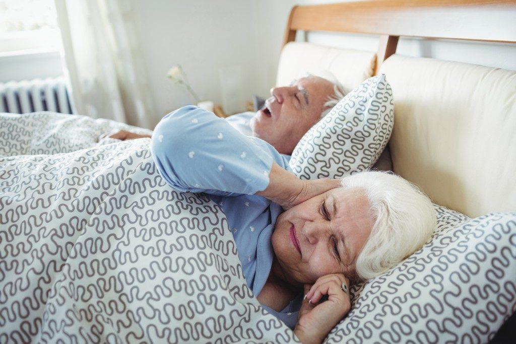 elderly man snoring in his sleep
