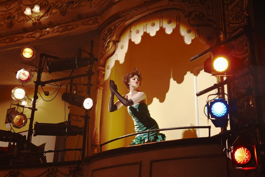 Low angle view of a woman in theatre box