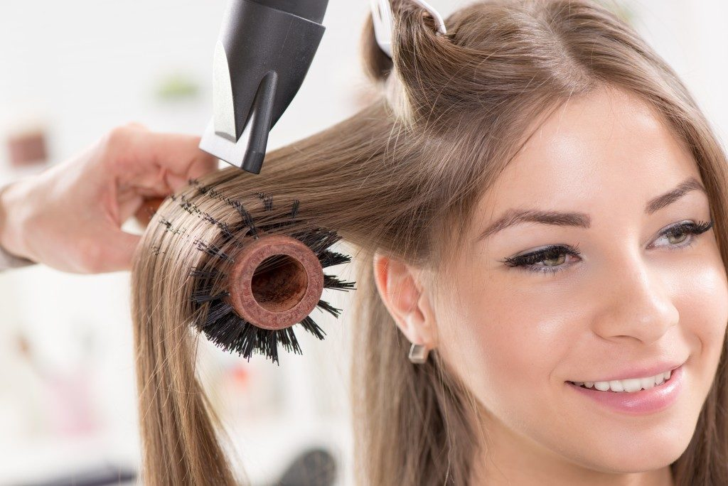 woman having her hair blowdried