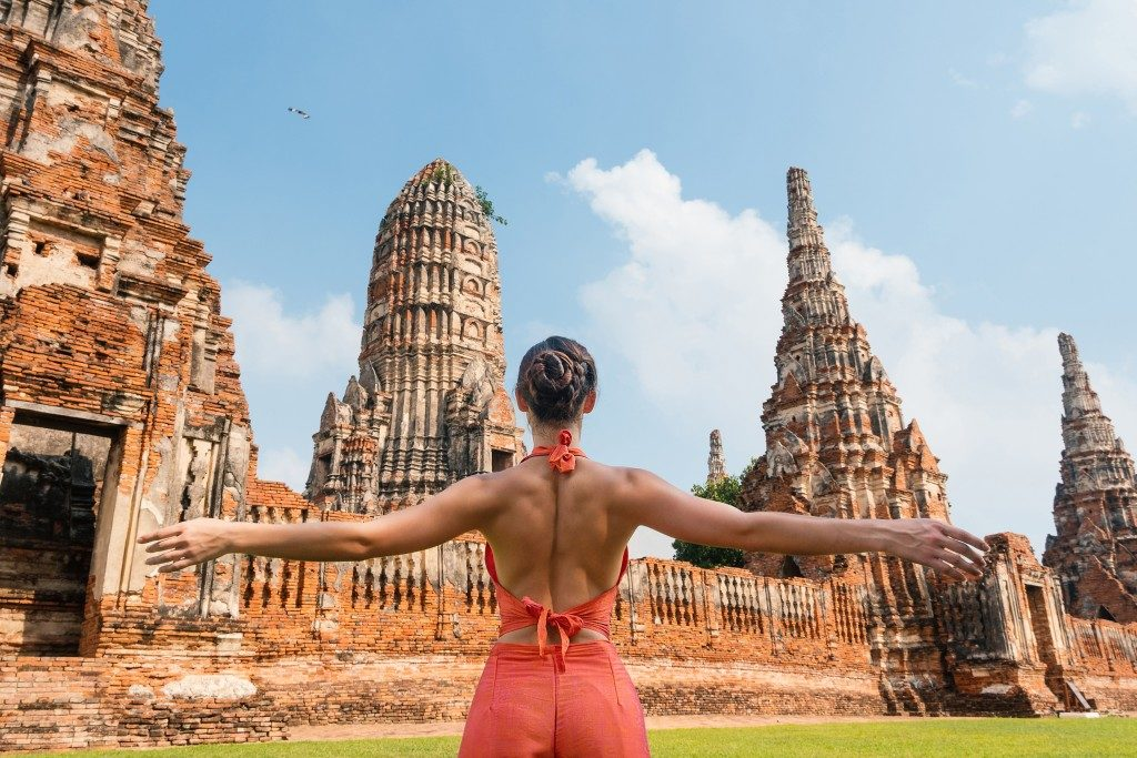 woman posed in front of the temples
