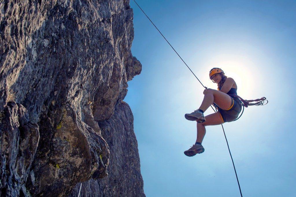 woman doing rock climbing