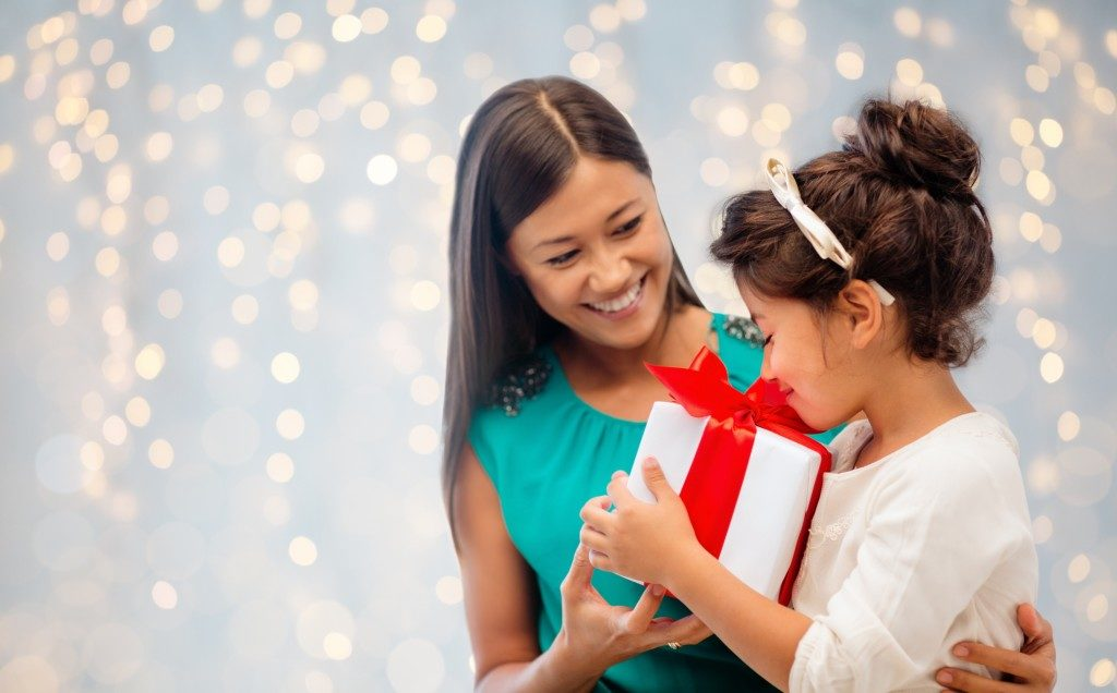 mother giving her daughter a gift