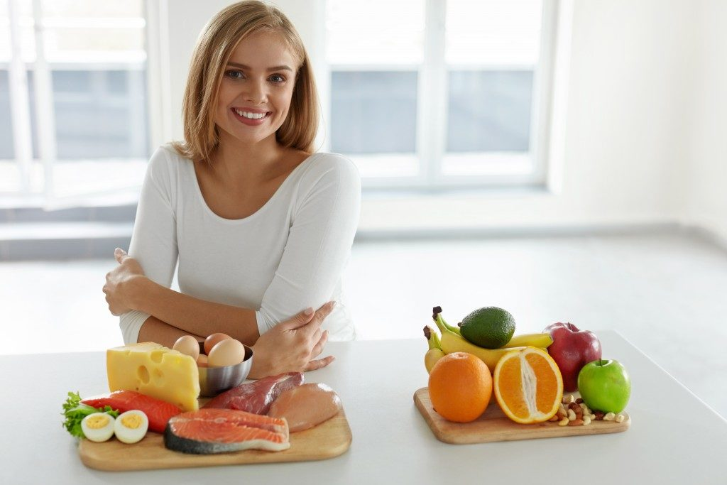 woman with healthy food on the table