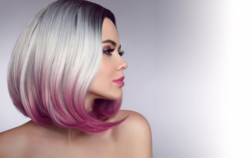 womna with grey and violet hair dye