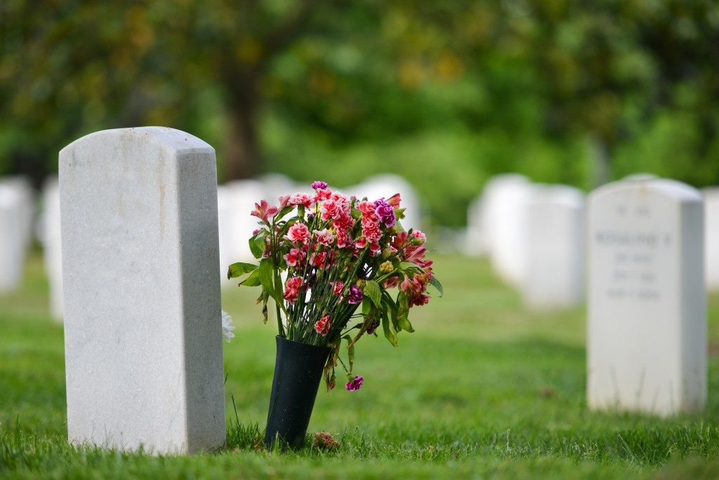 headstone with flowers beside it