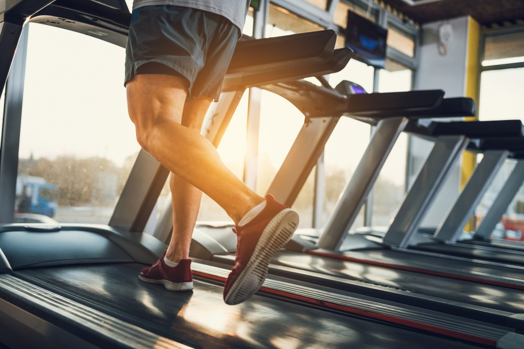 man running on a treadmill