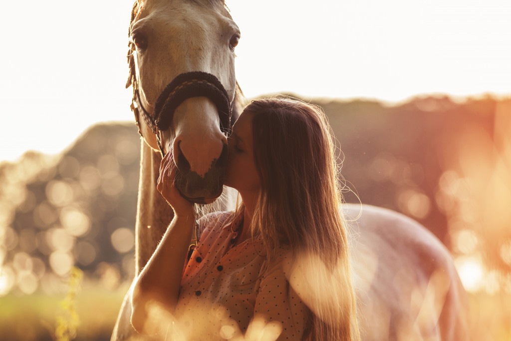 female kissing her horse