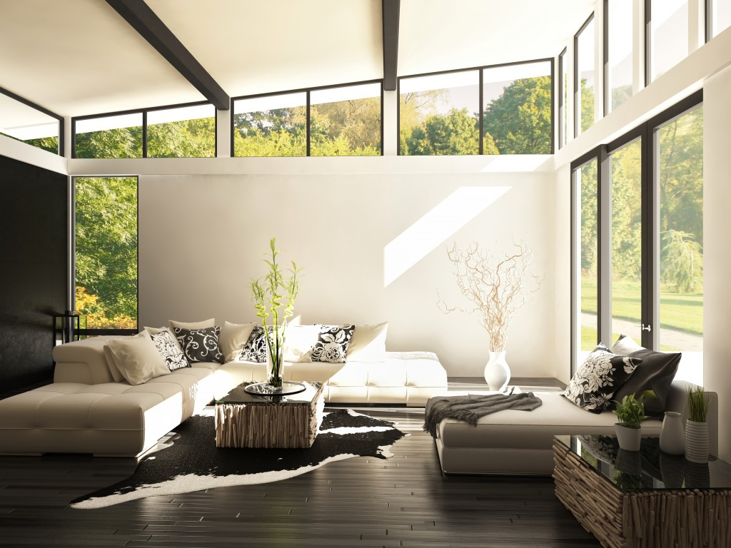 living room surrounded by windows