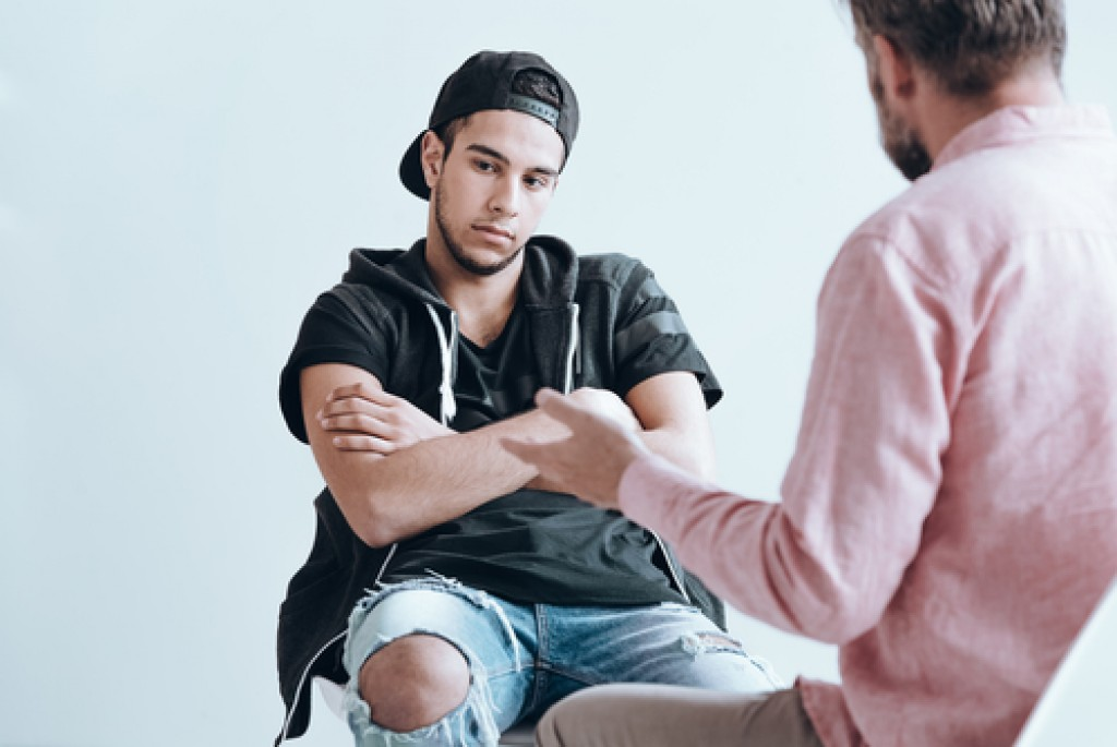 man consulting a therapist
