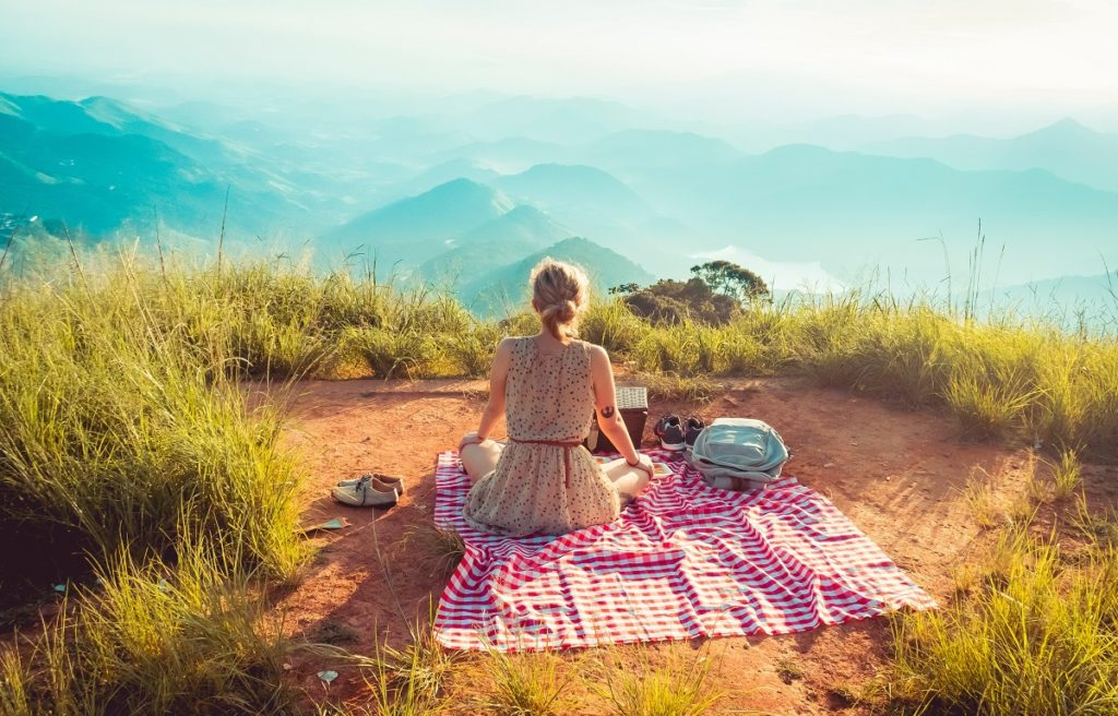 woman having a picnic on mountains