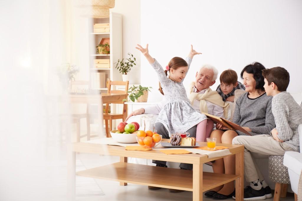 Elderly with their grand kids