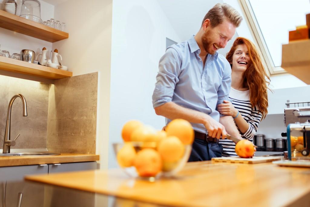 Couple making orange juice