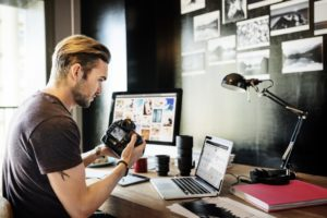 man editing his photos