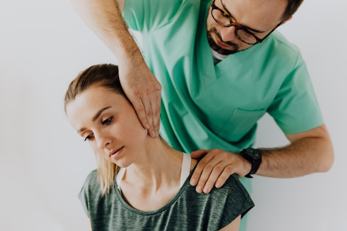 chiropractor attending patient with neck pain