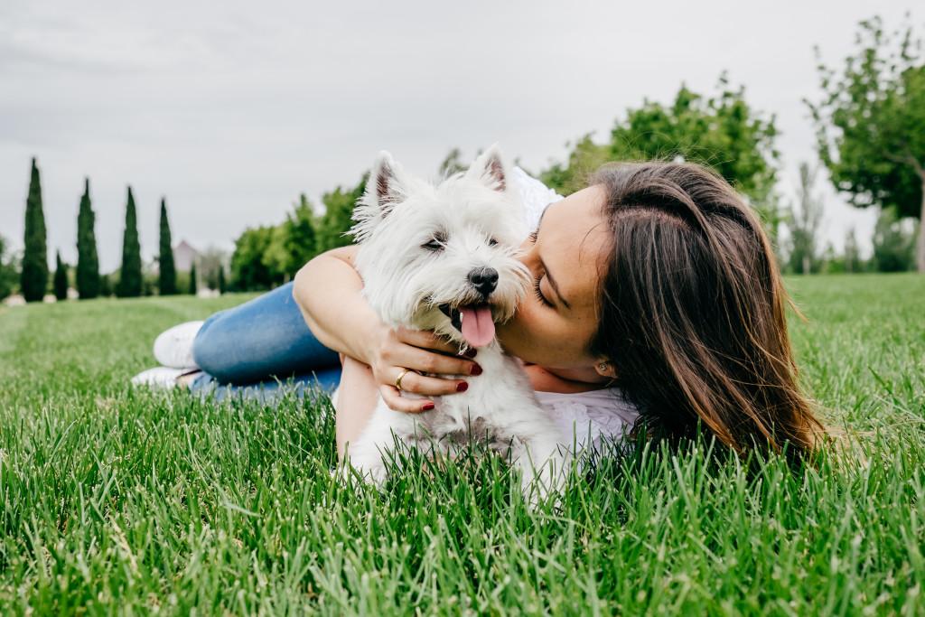 woman kissing a dog