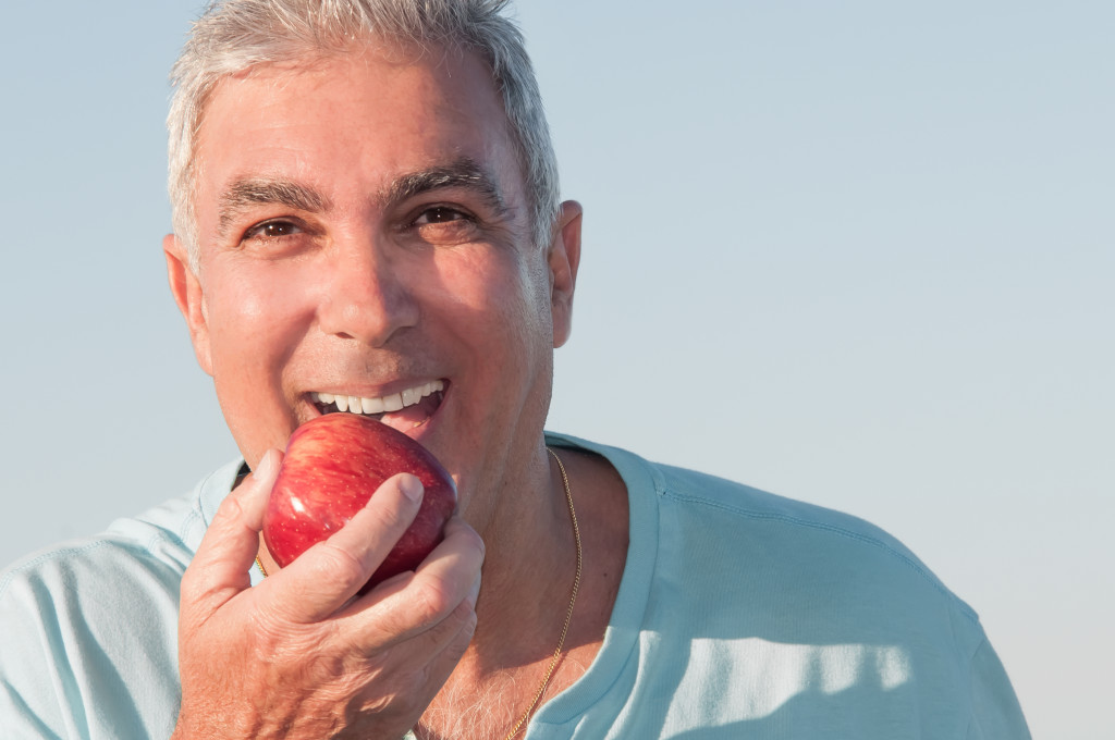 person eating apple