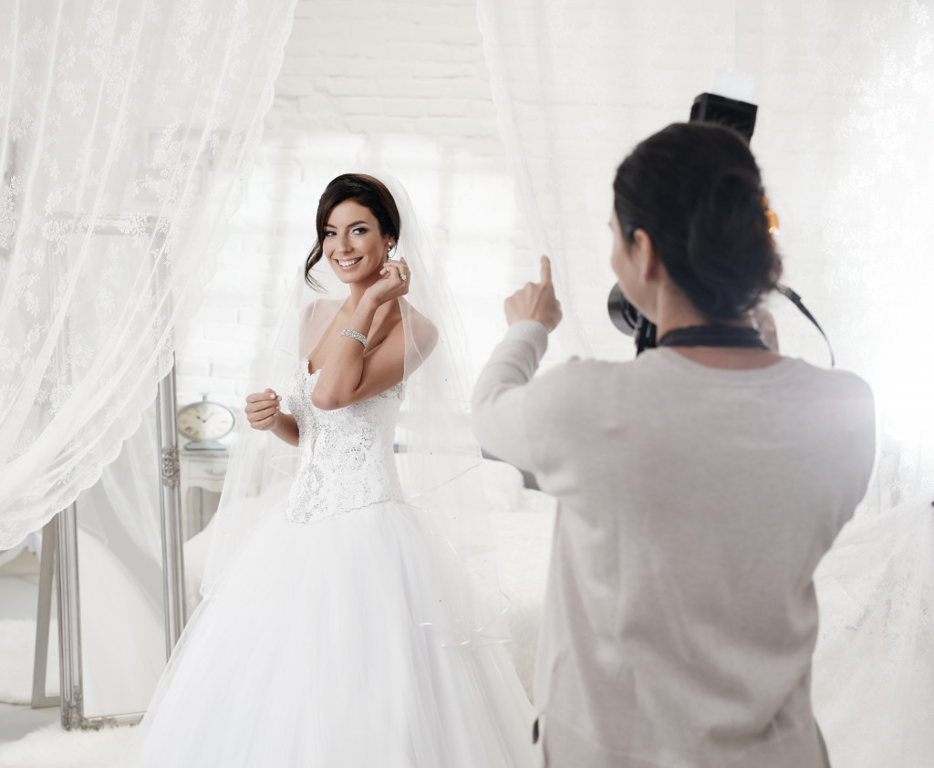 bride getting photographed
