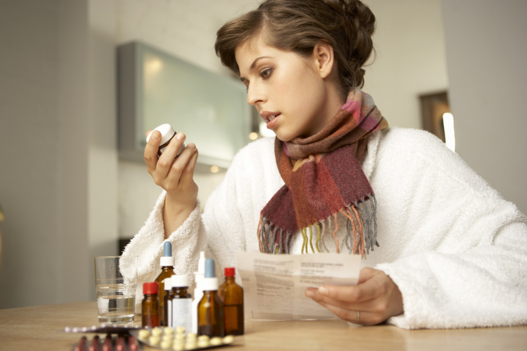 woman holding a bottle of medicine